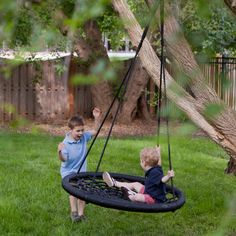Swing and Spin Swing - Swings at Hayneedle. . .I bet Aaron could figure out how to make one of these.