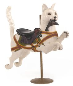 A carved and painted carousel cat attributed to Gustav Dentzel Philadelphia, early 20th century