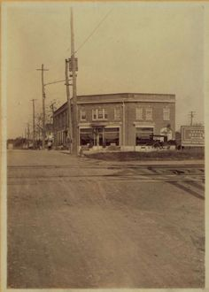 1910/11 photo showing the Rickert Finley Real Estate Bldg at 162nd St and Northern Blvd. Note the LIRR tracks are still at grade level. Also note the horse carriages tied up in front of the bldg.