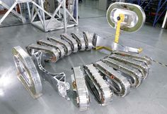 AMS Dipole and racetrack coil assembly