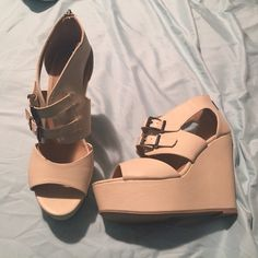 """Charlotte Russe Nude Wedges Brand new. Bought off of this app and thought I was going to love them, sadly I couldn't wear them. Too high for me . My loss is your gain. 5"""" heel with a 2"""" platform. Size 9. Charlotte Russe Shoes Wedges"""