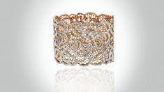 Katerina Maxine's lacy diamond bracelet is ethereal, refine, aristocratic. The use of rose gold gives the piece the warmth of the hearth, while the filigree work evokes the work of skilled craftsmen from days past.