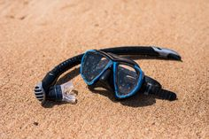 holidays background diving mask and flipflops on the ocean beach