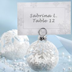 Flocked Glass Snowflake Ornament Placecard Holder (Set of 6) (Kate Aspen 27023NA) | Buy at Wedding Favors Unlimited (http://www.weddingfavorsunlimited.com/flocked_glass_snowflake_ornament_place_card_holder.html).