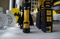 Cute Batman favor tubes in this Batman Themed Birthday Party via Kara's Party Ideas KarasPartyIdeas.com #BatmanParty #BoyParty #SuperheroParty #PartyIdeas #BatmanBirthdayPa...