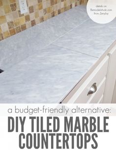 Beautiful! Self-installed tile marble countertops are a cheaper alternative to slab marble counters, so you can get the same beautiful look for a LOT less money @Remodelaholic