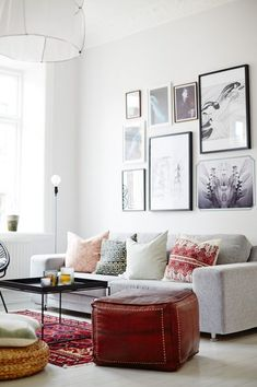 white living room with gray couch and kilim rug