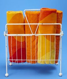 Use a wire magazine rack to hold beach towels so they are easy to grab as you head out to the pool.