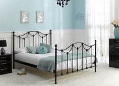 Our Kiera Bedstead in black stands out against simple white and teal decor and furnishings.