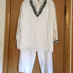 Two Piece Linen Crop Pant Suit White linen tunic and crop pants suit. Tunic has black beading on V neckline and sleeves. Cropped pants are lined. Great outfit to complete the summer. Tunic size L and pants size 12. Laura Ashley Other