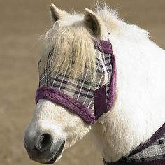 Kensington KPP Miniature Horse Fly Mask with Fleece, Deluxe Black Plaid, Mini by Kensington. $19.99. Mini Fly Mask with Fleece Trim, for added Comfort. Mask includes adjustability at crown as well as throat.