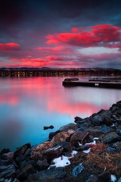Complimentary Colors Of Dawn - Sloan's Lake in Denver, Colorado invites visiotors to stop and enjoy the amazing sunrise on a March morning as it paints the sky blue and pink