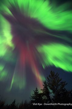 Do you see anything in this cascading aurora over northern Saskatchewan, Canada?