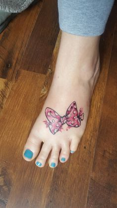 Disney Minnie mouse bow foot tattoo (Mrs. Frye) done by Laci @ 717 tattoo