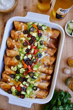 Rotisserie Chicken Enchiladas starring a quick-fix homemade enchilada sauce. They're easy, they're cheesy and they're about to give your local Mexican restaurant some serious competition. justataste.com #recipes #food #mexicanfoodrecipes #easydinner #easyrecipes #chicken #chickenrecipes #diy #justatasterecipes