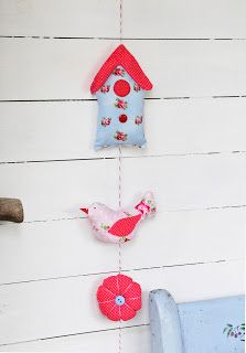 Helen Philipps:..this little bird is from my book *pretty patchwork gifts* and is part of a  hanging decoration which has a stuffed birdhouse and a flower too............