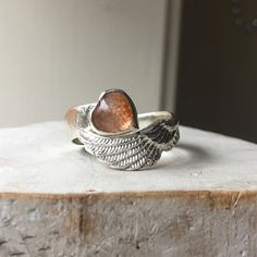 Sunstone Heart Angel Wing Ring with Silver Hammer Textured Wrap Band by kathysayce on Etsy https://www.etsy.com/au/listing/587408262/sunstone-heart-angel-wing-ring-with