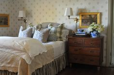 love these bedside sconces and especially the wooden chest as bedside table