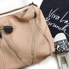 """Rebecca Minkoff Nude Moto Hobo Bag Details: • Leather • 13"""" L X 13.5"""" H X 4"""" D • Top handle (4"""" drop) and adjustable, detachable shoulder strap • Two exterior front zippers • Interior zip pocket and slip pockets • Magnetic closure  • NWT, no dust bag  05261602 Rebecca Minkoff Bags Hobos"""