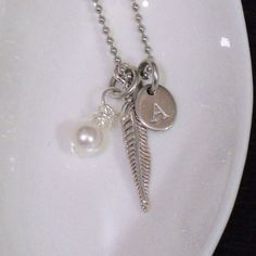 Custom stamped metal jewelry from Beckett Metal. $21. www.BeckettMetal.com. A gorgeous simple initial necklace statement.