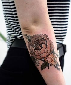 Sophia Baughan flower tattoo