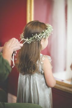 Flowers by Jennifer Pinder. Photo by Josh Gooding. Wedding flower girl crown with baby's breath (gypsophila) and tied with a white ribbon. Beautiful grey dress on this little one! xx