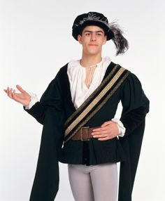 Man wearing 16th century Shakespeare-era costume, front view