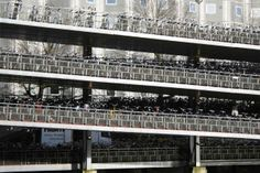 Centraal Station bike garage, Amsterdam, was opened in 2001 and can accommodate 2,500 bikes on three levels. Streets for Everyone >> http://www.pinterest.com/slowottawa/streets-for-everyone/