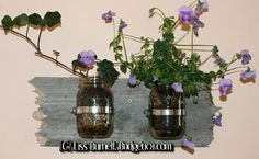Create your own Rustic Wall planter from reclaimed wood, a couple old mason jars and a few household plants! This adorable planter makes a great gift as well . . .