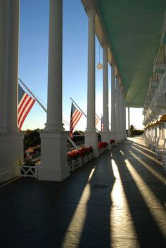 @Grand Hotel in #puremichigan is home to the World's Longest Porch, looking over The Straits of Mackinac and the Mackinac Bridge