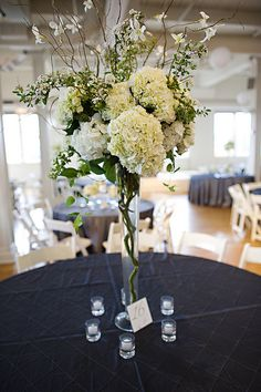 Tall Centerpiece with Hydrangea and Curly Willow Branches by Blue Bouquet, via Flickr