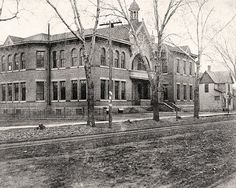 A photo c. 1900 photo of the first High School (albeit an expanded and altered building from the original) in Wichita, KS. The original High School building was built by W.H. Sternberg (1832 - 1906) who was the most prolific designer and builder in the Wichita area during one of the greatest economic booms in U.S. history.