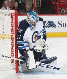 RALEIGH, NC - NOVEMBER 20: Connor Hellebuyck #37 of the Winnipeg Jets makes a glove save during an NHL game against the Carolina Hurricanes on November 20, 2016 at PNC Arena in Raleigh, North Carolina. (Photo by Gregg Forwerck/NHLI via Getty Images)