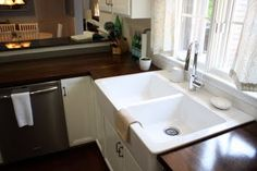 Love these stained butcher block countertops and LOVE LOVE this farmhouse sink