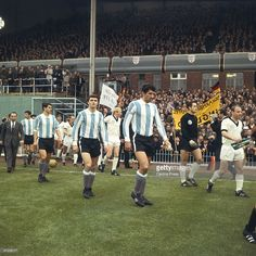 Team captains Antonio Rattin and Uwe Seeler leading out Argentina and West Germany at Villa Park for their Group B match during the 1966 World Cup in England, 16th July 1966.