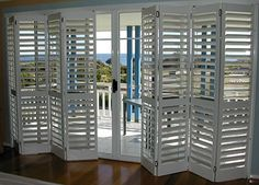 Bi-fold plantation shutters - can be installed with or without track. Interior Window Shutters, Interior Windows, Indoor Shutters, Interior Paint, Stores Horizontaux, Glass Door Coverings, Patio Door Coverings, Door Window Treatments, Shutter Doors