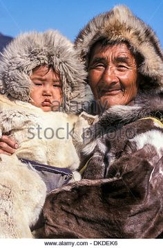 Grandfather proudly holds his young grandson, Yanrakynnot, Russia - Stockbild