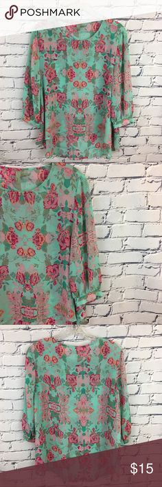 """Mint Green Floral Top Mint Green Floral Top with high low hemline and ¾ length sleeves.   🌸Size: Small 🌸Chest: 19"""" (flat lay, pit to pit} 🌸Front Length: 17.5"""" (neckline to hem)      Back Length: 25.5"""" (shoulder to hemline) 🌸Material: 100% Polyester Forever 21 Tops Blouses"""