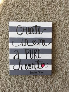 This grey and white striped painting is an 8X10. Create In Me A Pure Heart is featured in black writing, as well as where the verse is found in