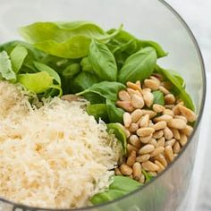 -----------How to Make Pesto------------- Serves: 1 1/2 cups Ingredients 3 cups packed fresh basil leaves 4 cloves garlic 3/4 cup grated Parmesan cheese 1/2 cup olive oil 1/4 cup pine nuts, toasted 1/2 tsp salt