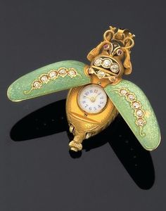 An early to century gold, diamond and enamel 'Beetle' pendant watch. Insect Jewelry, Jewelry Art, Antique Jewelry, Vintage Jewelry, Antique Watches, Antique Clocks, Vintage Watches, Objets Antiques, Cross Pendant