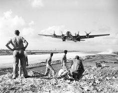 December 1944: U.S. soldiers at the Saipan airbase, in the Mariana Islands, watch as a B-29 Superfortress takes off for an air raid on the Japanese mainland. (AP Photo) #