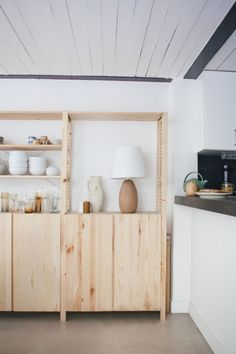 """Modern Thrift: Lucile Demory's Architect-Designed Rental in Paris - Remodelista - Two side-by-side pine Ivar Shelving Unitsfrom Ikea hold Lucile's things, from """"years of collect - Ikea Shelving Unit, Ikea Shelves, Modern Loft Apartment, Apartment Design, Loft Apartments, Modern Lofts, Contemporary Apartment, Loft Spaces, Office Spaces"""