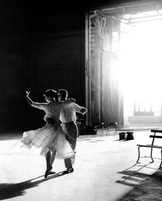 Audrey Hepburn and Fred Astaire dancing.
