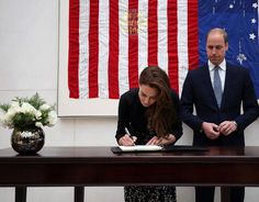 The Duke and Duchess of Cambridge signing a book of condolence for Orlando shooting victims at the US Embassy in London
