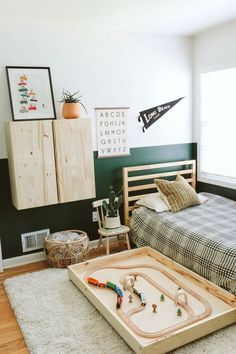 modern kid room with pull out train table boys room ideas, boy bedroom decor, boy bedroom design, boy bedroom furniture, boy room artwork ideas with dark green walls Decor Room, Bedroom Decor, Home Decor, Bedroom Lamps, Wall Lamps, Modern Bedroom, Bedroom Furniture, Trendy Bedroom, Baby Bedroom