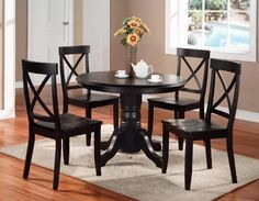 Home Styles 5178-318 5-Piece Dining Set, Black Finish  This dining set includes a round pedestal dining table and four side chairs is made of solid hardwood. Sports suggests a country/cottage style while its rich, bold black finish provides an updated feel. It is especially well suited for smaller rooms. A clear coat finish helps to guard against wear from normal use. Easy assembly. Table measures 42-inch diameter by 30-inch height. Chair measures 18-4/5-inch width by 22-1/4-inch dep..