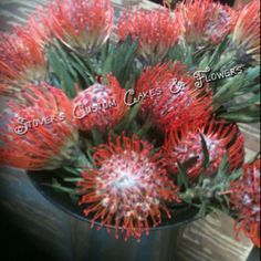 Wedding flowers Hawaiian protea pincushion flowers tropical bouquet red orange exotic arrangement
