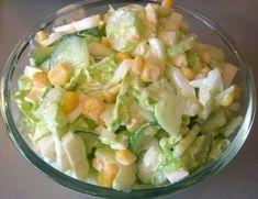 Фото к рецепту: Салат с капустой, огурцами и кукурузой
