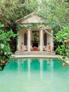 Small pool house with white furniture and colorful cushions with a hanging light backyard cabana Small Pool Houses, Houses With Pools, Outdoor Spaces, Outdoor Living, Outdoor Lounge, Outdoor Pool, Pavillion, Piscina Interior, Dream Pools